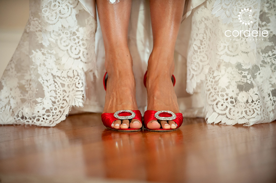A brides Red  Louis Vuitton shoes for her wedding