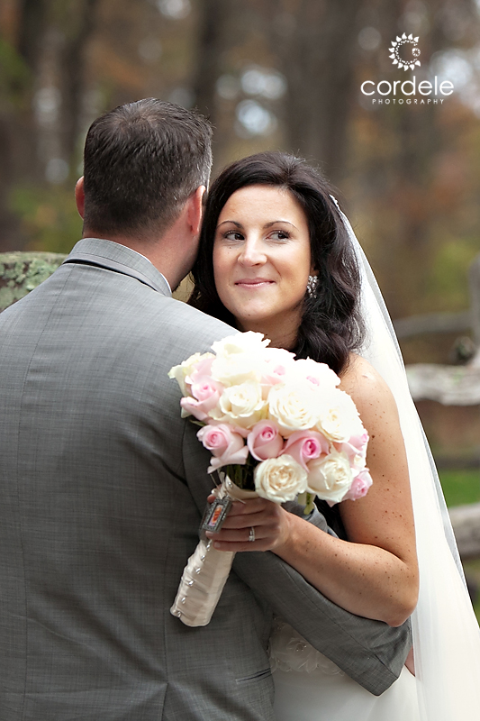 A Bride looks over the grooms shoulders at the Wayside Inn